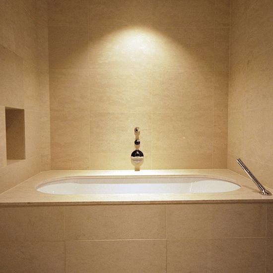 Tiling around the bath area of Kensington property