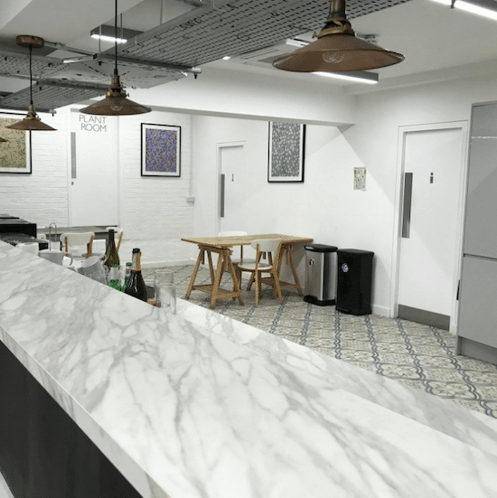 Kitchen area of London office tiled