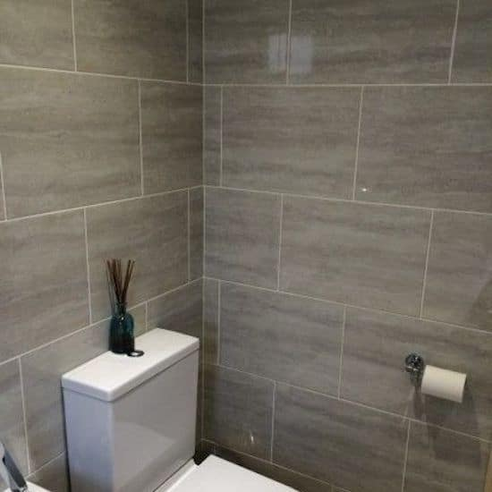 Tiling around the toilet of bathroom in Sutton House