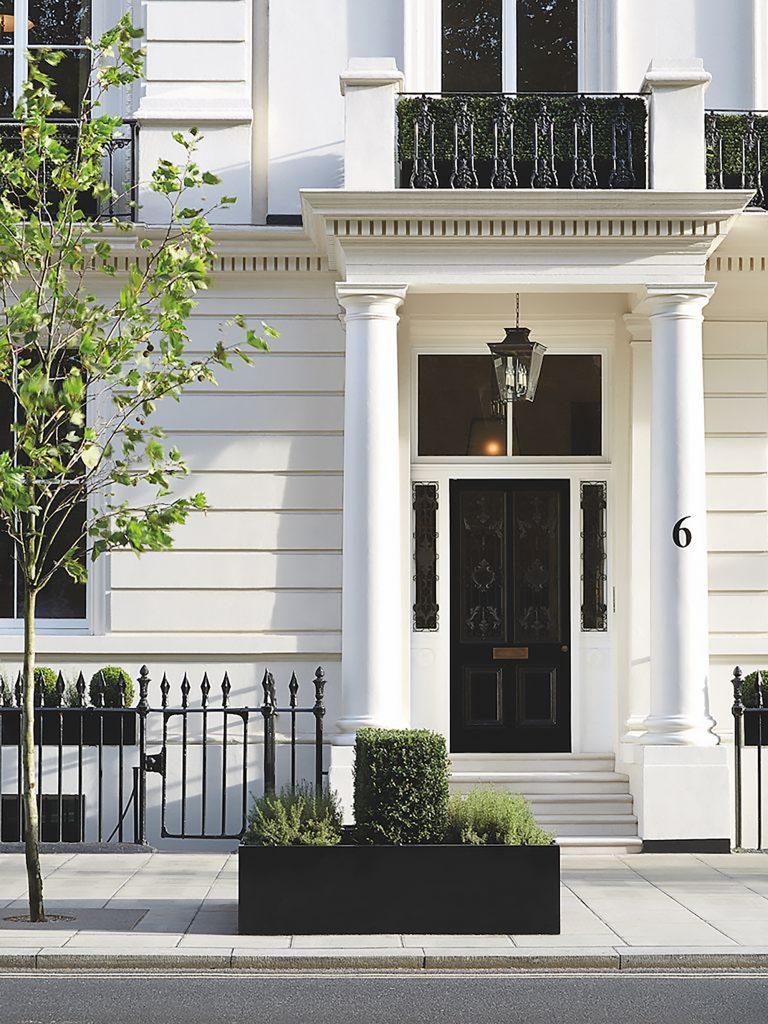 Front door of No.6 Buckingham Gate painted in black