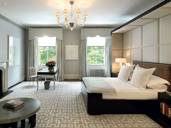 Master bedroom painted in light grey inside mansion located at No.6 Buckingham Gate
