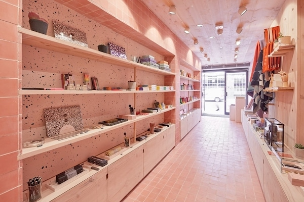 pink tiled floor and walls of Papersmiths retail store