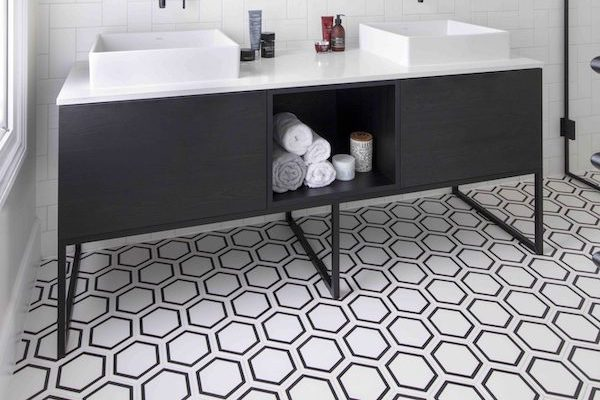 black and white geometric patterned tiles in bathroom of house located on Osterley Road
