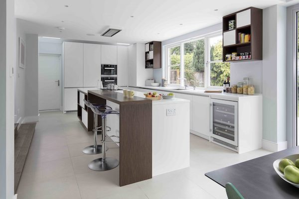 cream ceramic floor tiles in kitchen of house located on Osterley Road