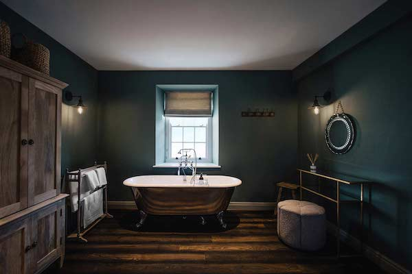 bathroom with dark wooden flooring