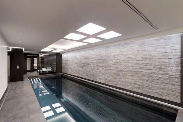 dark grey ceramic tiles laid in private swimming pool inside mansion located at No.6 Buckingham Gate