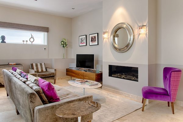 living room with marble effect tiles and white walls