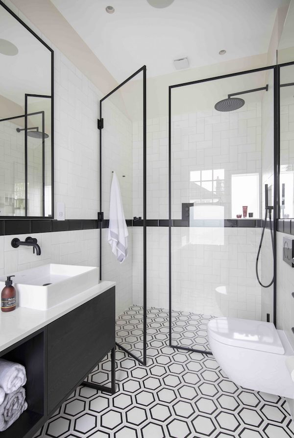 geometric floor tiles in bathroom with black fixtures and finishes located on Osterley Road