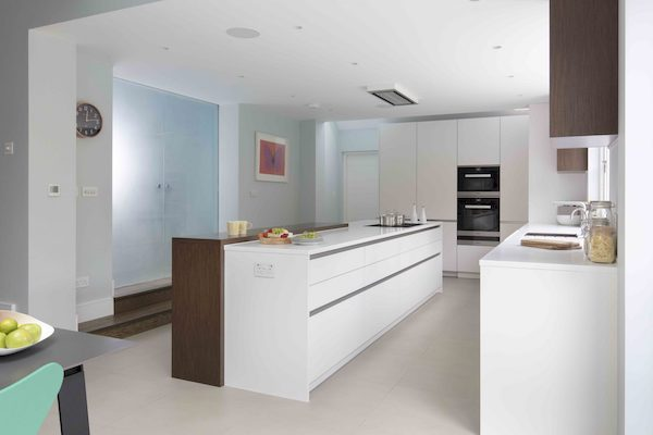 glossy white pantry furniture in tiled kitchen of house located on Osterley Roadglossy white pantry furniture in tiled kitchen of house located on Osterley Road