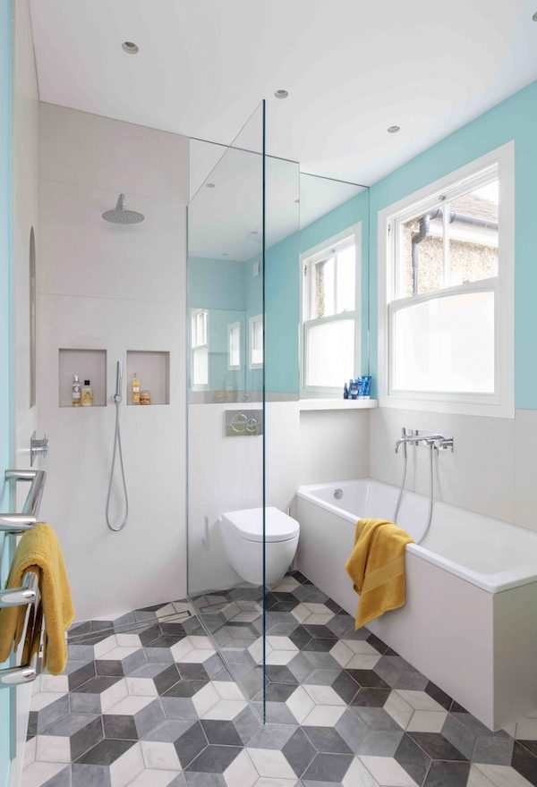 grey geometric floor tiles in bathroom painted in blue and white in house located on Osterley Road