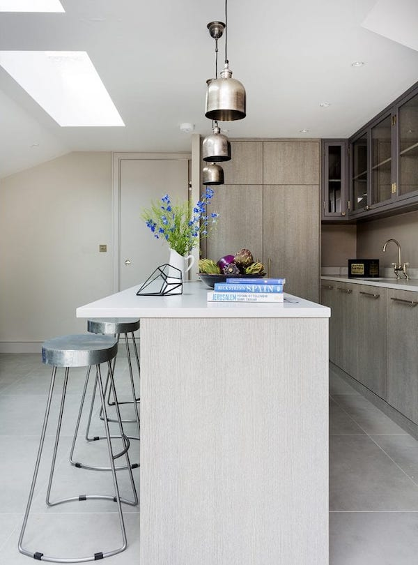 kitchen covered with large light grey tiles
