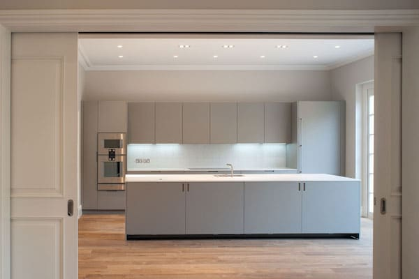 white coloured kitchen with sliding doors
