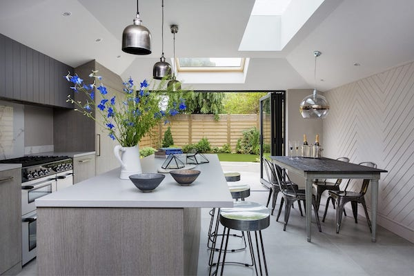 bespoke kitchen decorated with large grey floor tiles