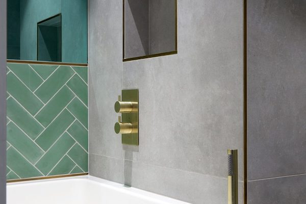 large grey tiles with gold trim in bathroom on Glenarm Road