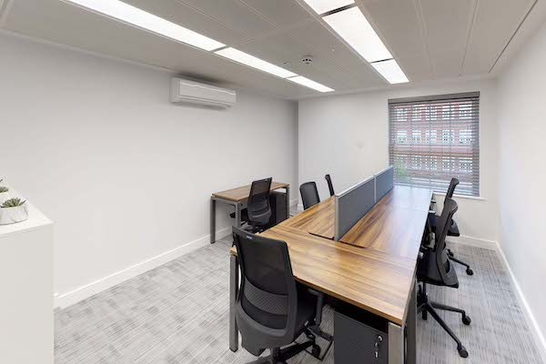 meeting room with white walls and carpet