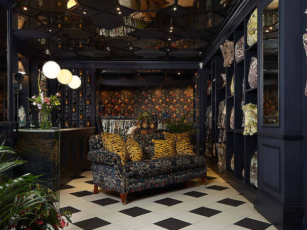 shop lounge decoreated with dark theme and black and white ceramic tiles