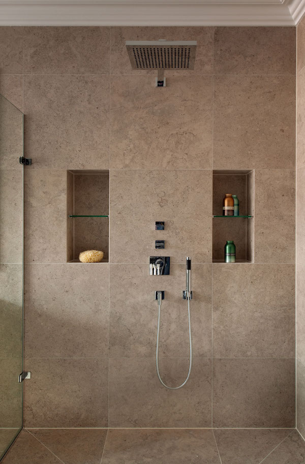 shower room covered in large square tiles