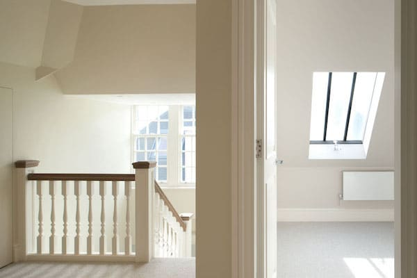 stairway to master bedroom painted in white