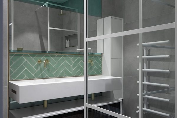 white sanitary ware in bathroom tiled with grey and green tiles in house on Glenarm Road