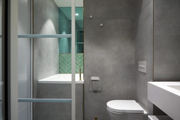 white sanitary ware in bathroom tiled with grey tiles in house located on Glenarm Road
