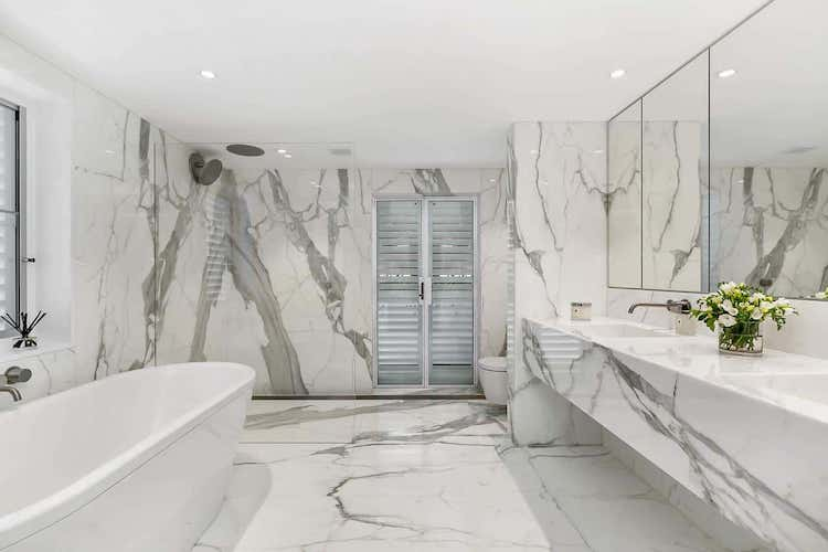 Bathroom tiled with marble tiles